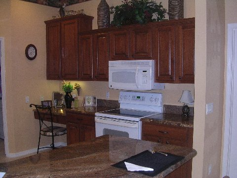 Dark wood cabinets after refacing by Kitchen Facelifts
