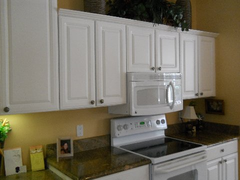 White cabinets before refacing by Kitchen Facelifts