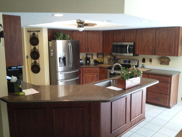 Kitchen Island and cabinets after Kitchen Facelifts refacing