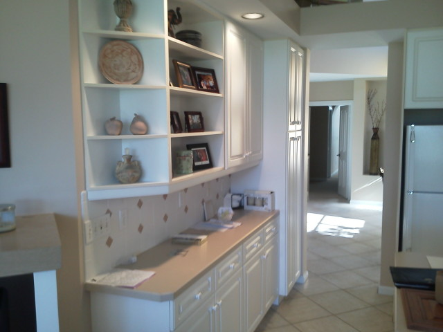 Before cabinet refacing, kitchen shelves and counter