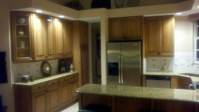 After cabinet refacing, solid maple doors, honey stain with black glaze, kitchen shelving view