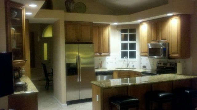 After cabinet refacing, solid maple doors, honey stain with black glaze, full kitchen view