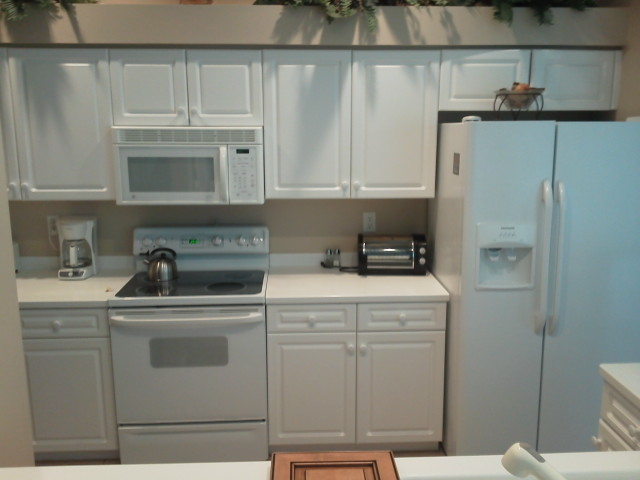 All white kitchen cabinets before Kitchen Facelifts cabinet refacing