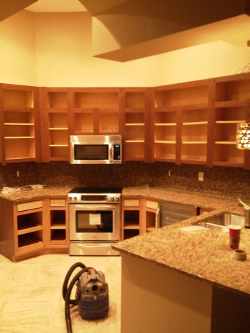 Cabinet doors removed during Kitchen Facelifts refacing work