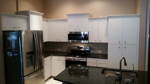 Plain white cabinets before Kitchen Facelifts refinishing