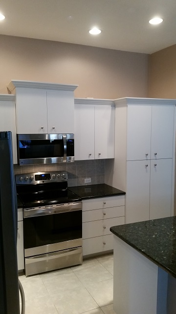 Before these plain white cabinets were refinished by Kitchen Facelifts of Southwest Florida