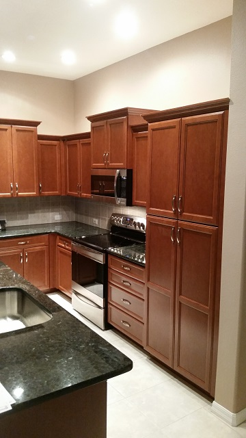 Kitchen Facelifts of Southwest Florida did a beautiful job refacing plain white cabinets with a rich wood style.