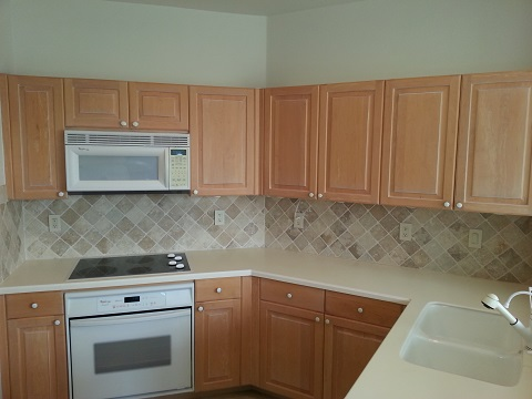 Outdated cabinets in the kitchen before refacing done by Kitchen Facelifts in Southwest Florida