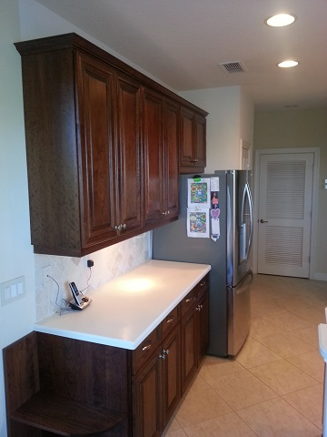 Beautiful updated dark wood kitchen cabinets after refacing by Kitchen Facelifts in Southwest Florida