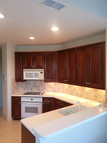 Kitchen Facelifts in Southwest Florida refaced these cabinets with a dark wood tone to update their look