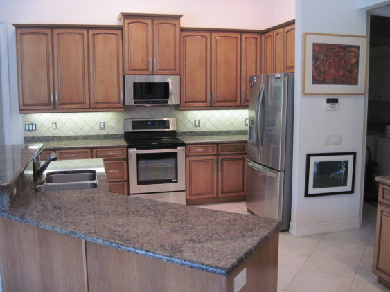 The cabinet refacing done for this kitchen matches the style of the interior and gives added value to the home
