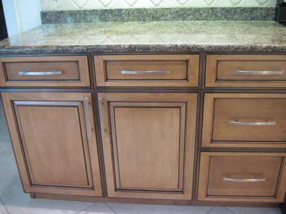 These cabinets have been refaced by Kitchen Facelifts to give them a warm tone and an updated look.