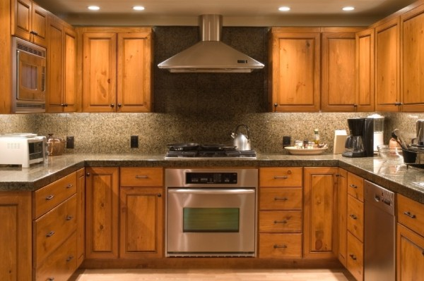 Kitchen Facelifts completed this beautiful cabinet refacing project to give this kitchen a warm and upscale look.